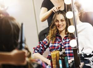 Women at beauty parlour having haircut and make up treatment