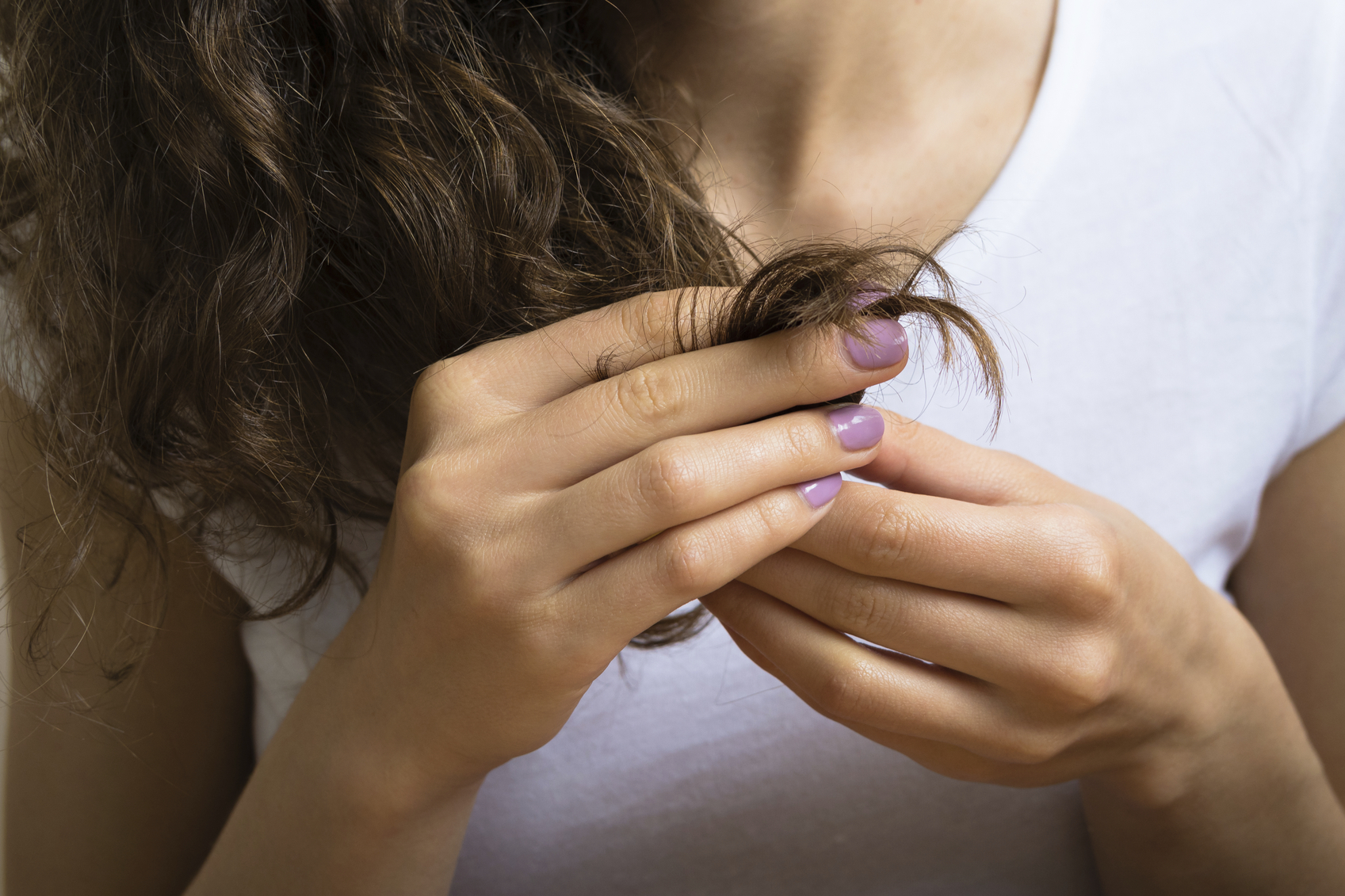 Female hand holding the hair ends