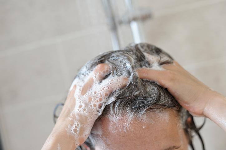 Woman in Shower Washing her Hair