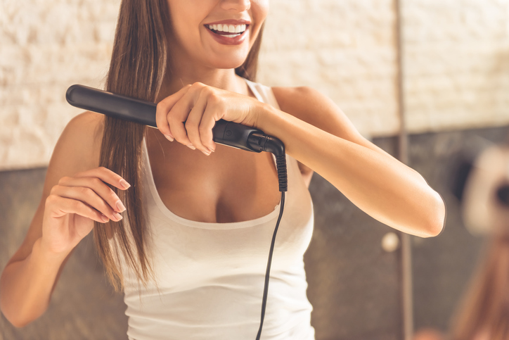 everyday hairstyles that can cause damage: straightening your hair every day