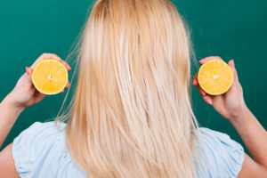 Woman-blonde-hair-lemons-vitamin-C-healthy-anemia-hair-loss
