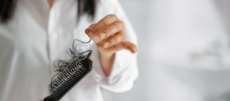 woman-hair-brush-thinning-DHT-hair-loss