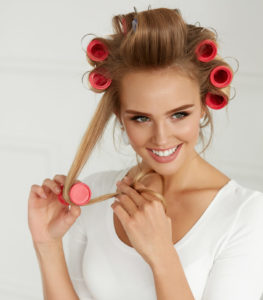 rollers-blonde-woman-happy-avoid-heat-damaged-hair