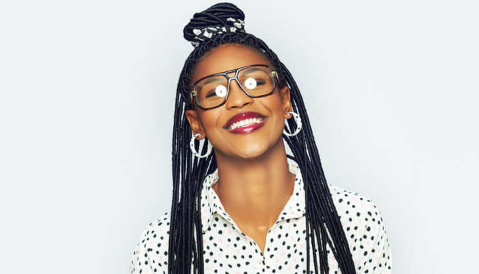 top-knot-half-up-braids-black-woman-easy-travel-hairstyles