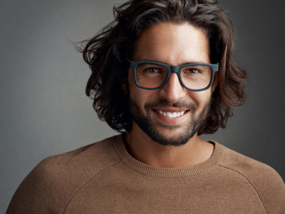 man-wavy-hair-long-haircut-glasses-understanding-hair-textures-toppik-blog-image