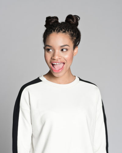 pigtail-buns-african-american-happy-woman-easy-gym-hairstyles-toppik-blog
