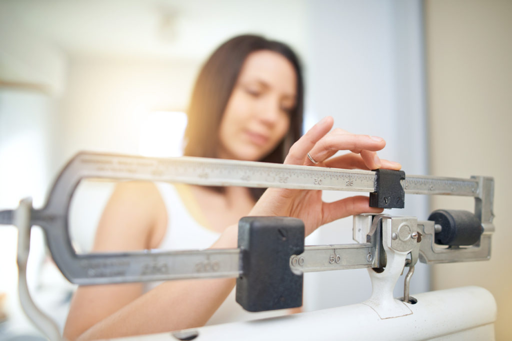 scale woman weight loss and hair loss toppik hair blog