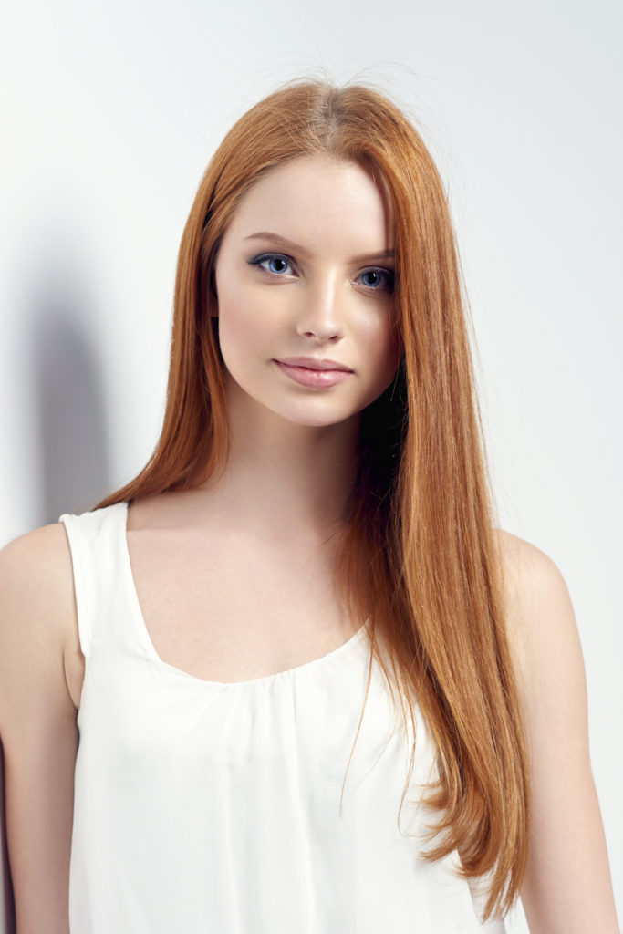 redhead long straight hair oval face best hairstyles face shape Toppik blog
