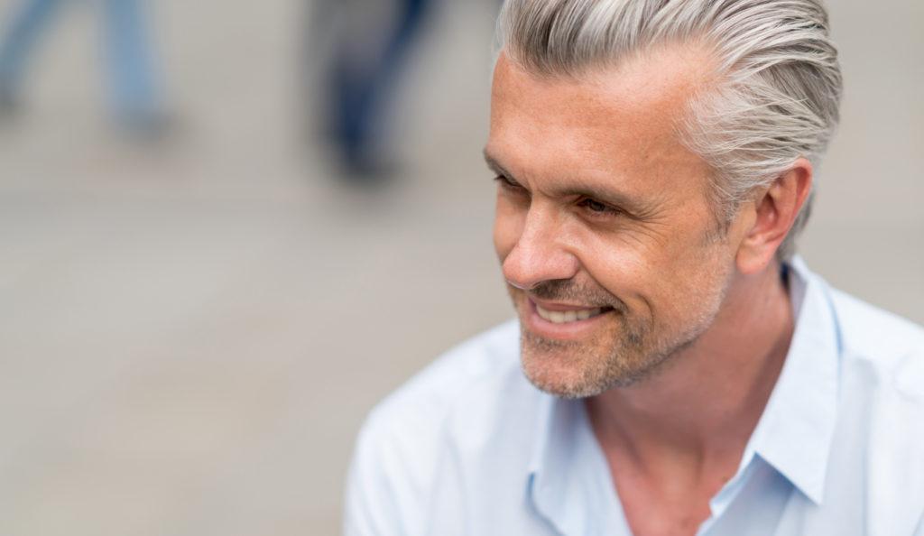 gray silver hair smiling man causes gray hair toppik hair blog