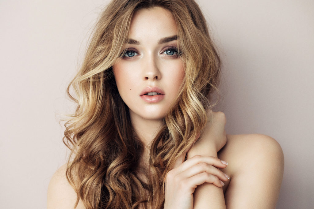 long hair curly woman round face hairstyles face shapes toppik blog