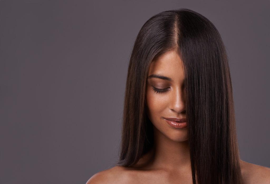 long hair dark brown hair woman spotting telogen effluvium symptoms toppik hair blog