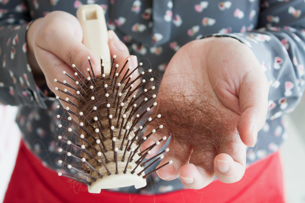 hair thinning shedding hair brush spotting telogen effluvium symptoms toppik hair blog
