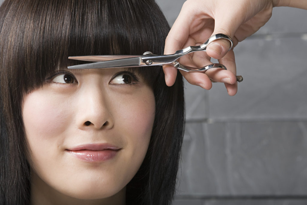 haircut bangs asian woman closeup face smiling best bangs for thin hair toppik hair blog