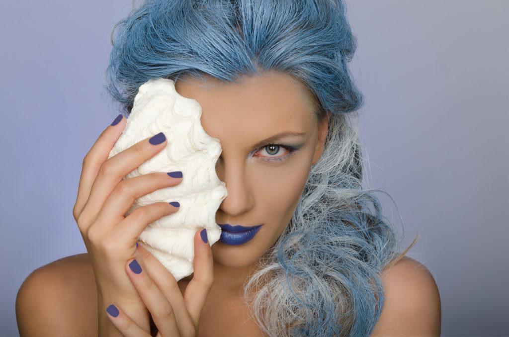 blue hair seashell blue lipstick woman ethereal mermaid halloween hairstyles toppik hair blog