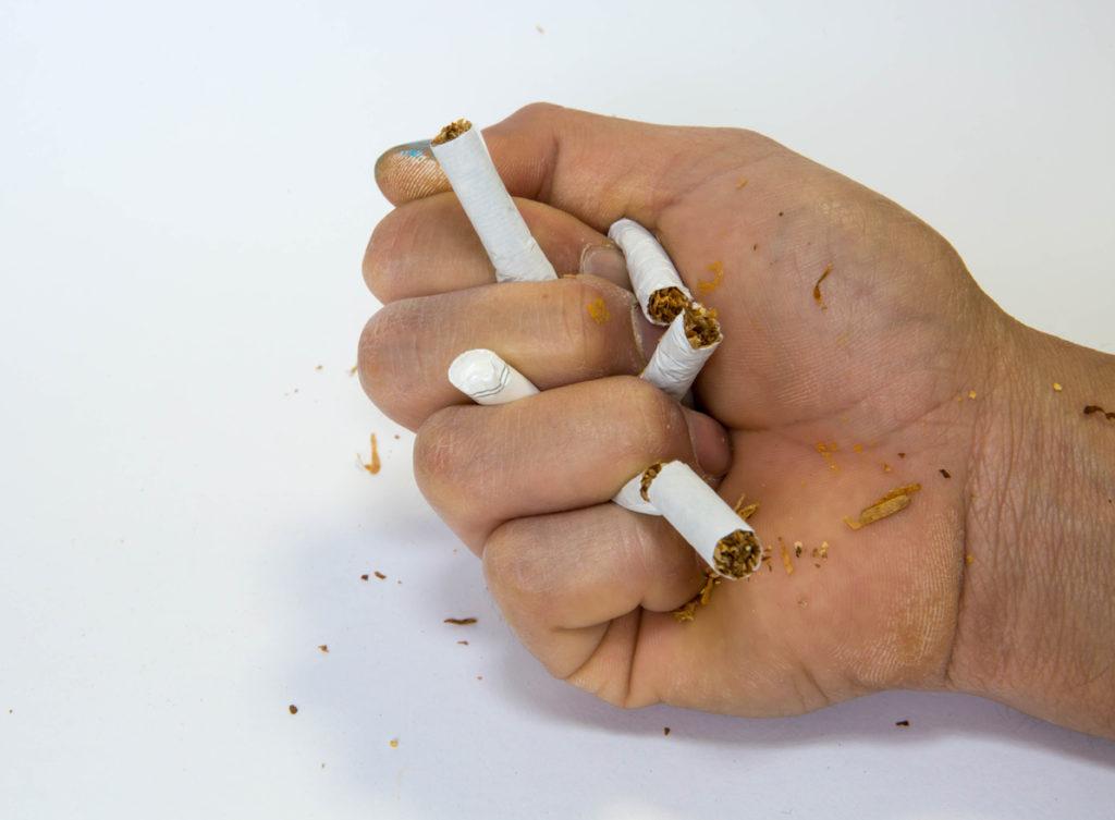 hand breaking cigarettes does smoking cause hair loss toppik hair blog