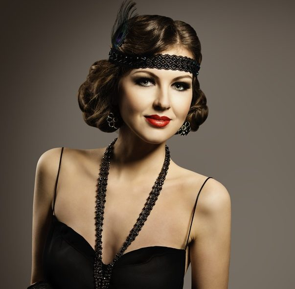 costume 1920s flapper girl dark background bob halloween hairstyles toppik hair blog