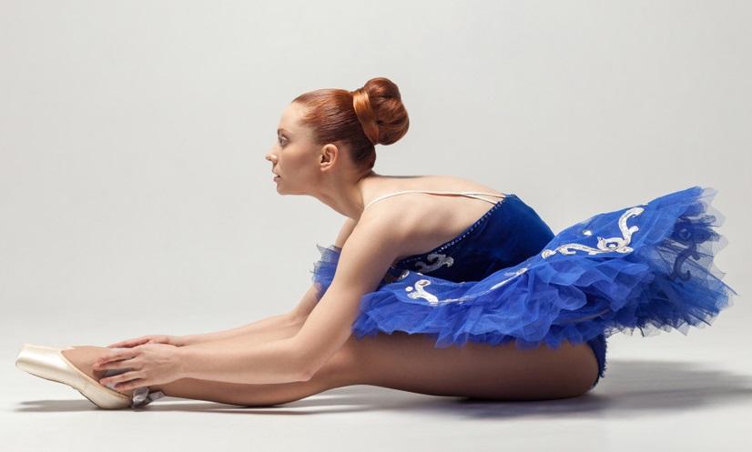 Ballet Dancer sitting stretching blue tutu sleek bun hair halloween hairstyles toppik hair blog