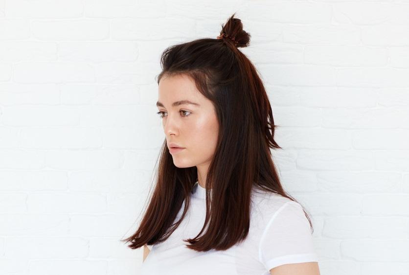 half bun updo hairstyle baby bun best holiday hairstyles toppik hair blog