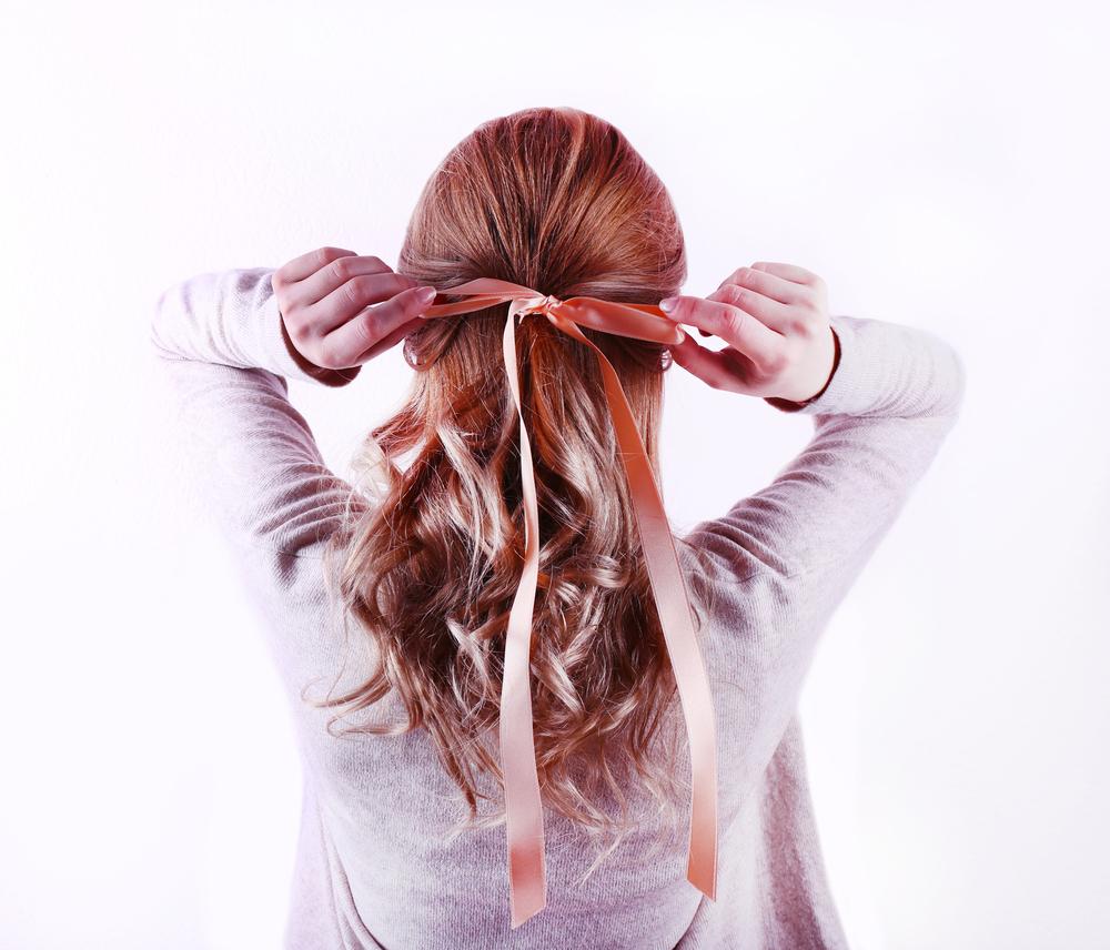ribbon bow long hair back favorite holiday hairstyles toppik hair blog