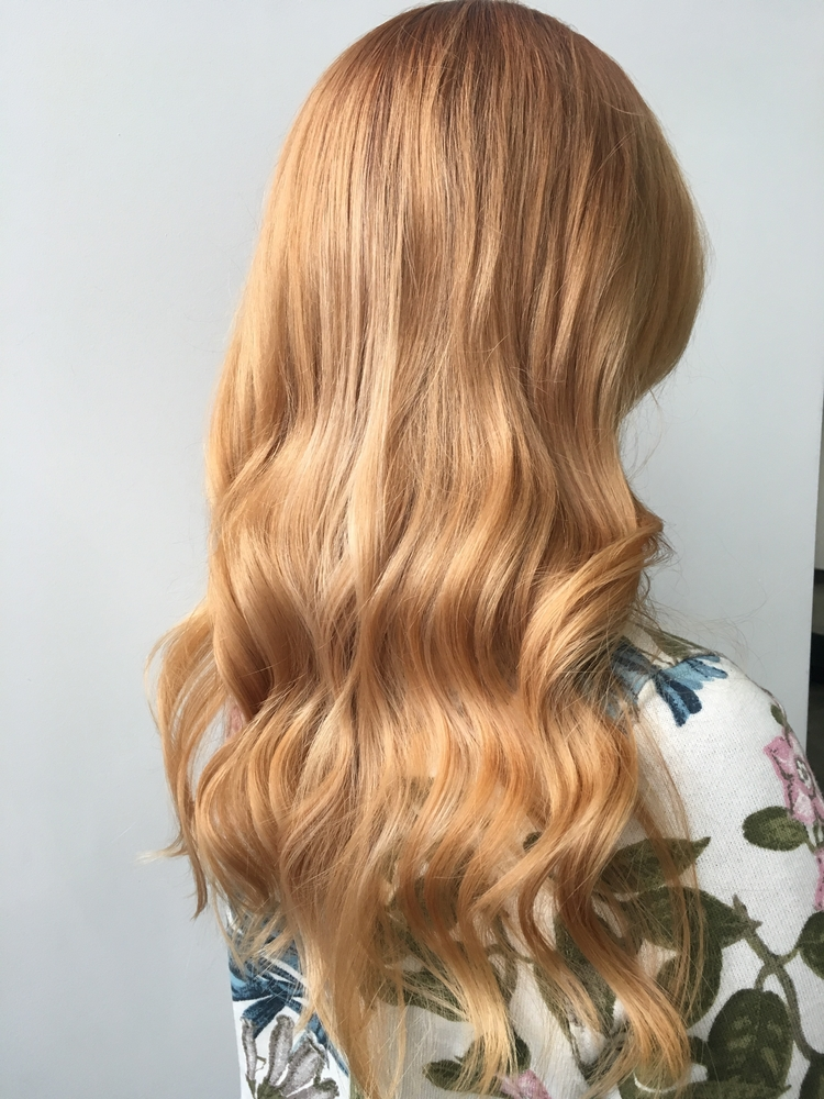 strawberry blonde hair long curly side view choosing hair colors for older women toppik hair blog