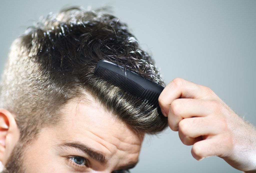 combing hair man closeup shiny hair when is hair conditioner for men necessary? toppik hair blog