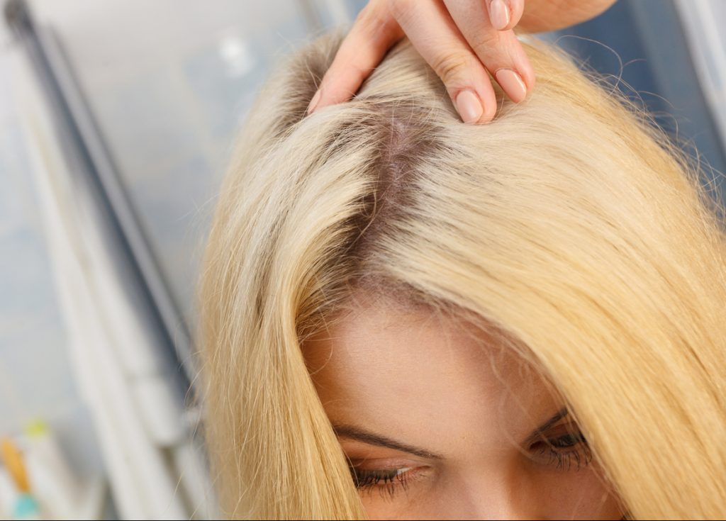 hair part dark roots blonde woman avoiding bleach damaged hair toppik hair blog