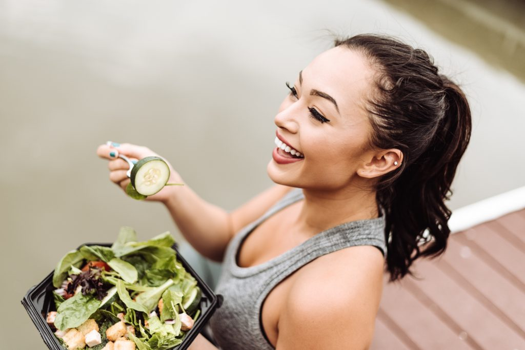 happy fitness woman ponytail healthy eating salad tips for growing out short hair toppik hair blog