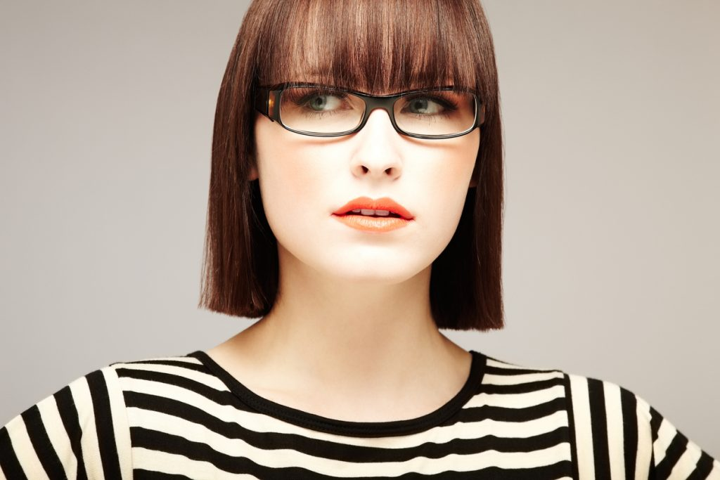 brunette woman blunt short hair bangs fringe our favorite bob haircuts for thin hair toppik hair blog
