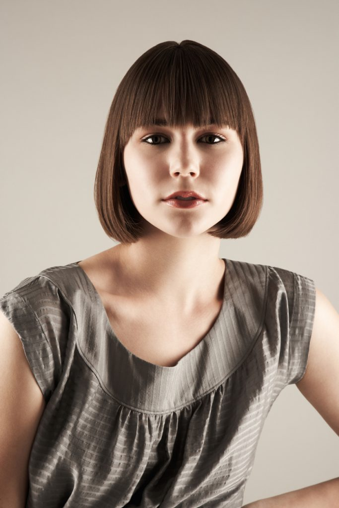 brunette woman curled under bob short hairstyle our favorite bob haircuts for thin hair toppik hair blog
