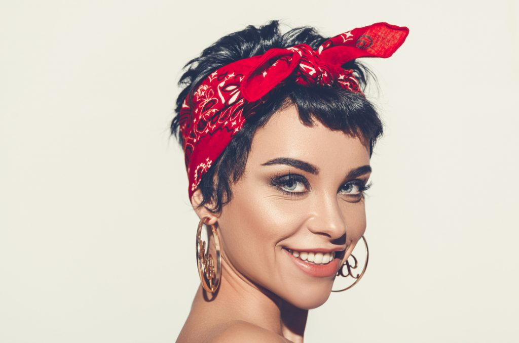 smiling girl short hair headband earrings tips for growing out short hair toppik hair blog