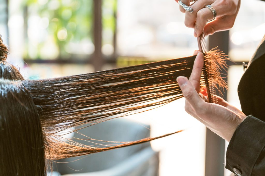 stylist salon haircut trim split ends tips for growing out short hair toppik hair blog