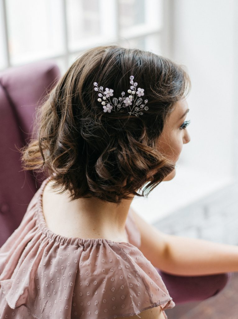 brunette floral hair accessory short hair half back lob our favorite wavy hairstyles toppik hair blog