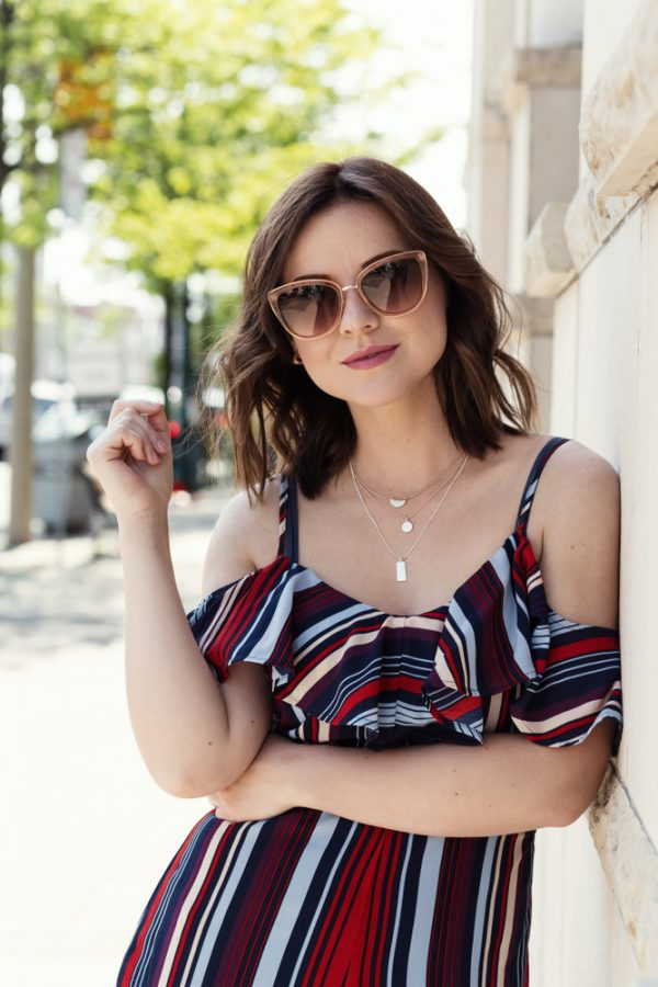 brunette woman outside sunglasses center parted lob our favorite wavy hairstyles toppik hair blog