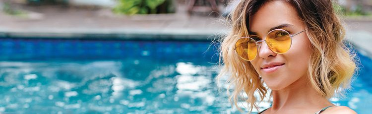 pool summer blonde girl sunglasses happy warm weather haircuts for summer hair toppik hair blog