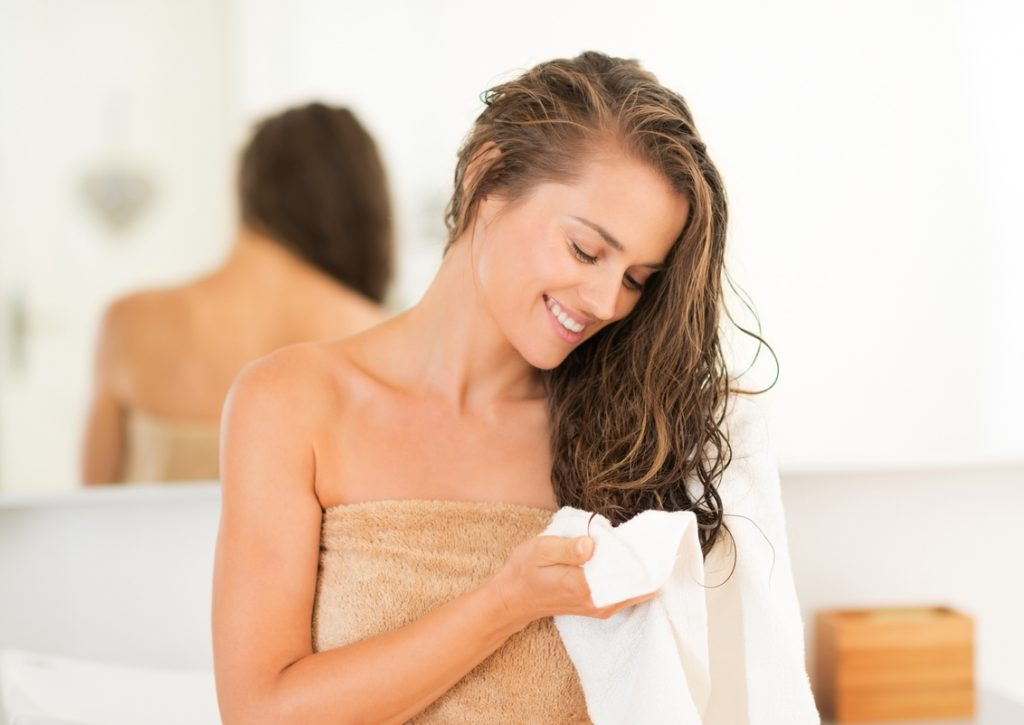 woman bathroom wet hair towel drying how to deal with humidity hair toppik hair blog