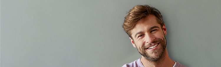 man smiling short haircut hairstyle gray background handsome our favorite short haircuts for men toppik hair blog