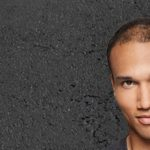 man gray background shaking fibers hairline using toppik hair fibers to fix a receding hairline toppik hair blog