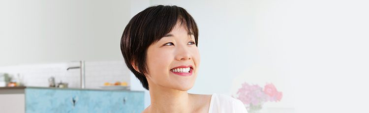 smiling woman short hair Asian best short haircuts for women toppik hair blog