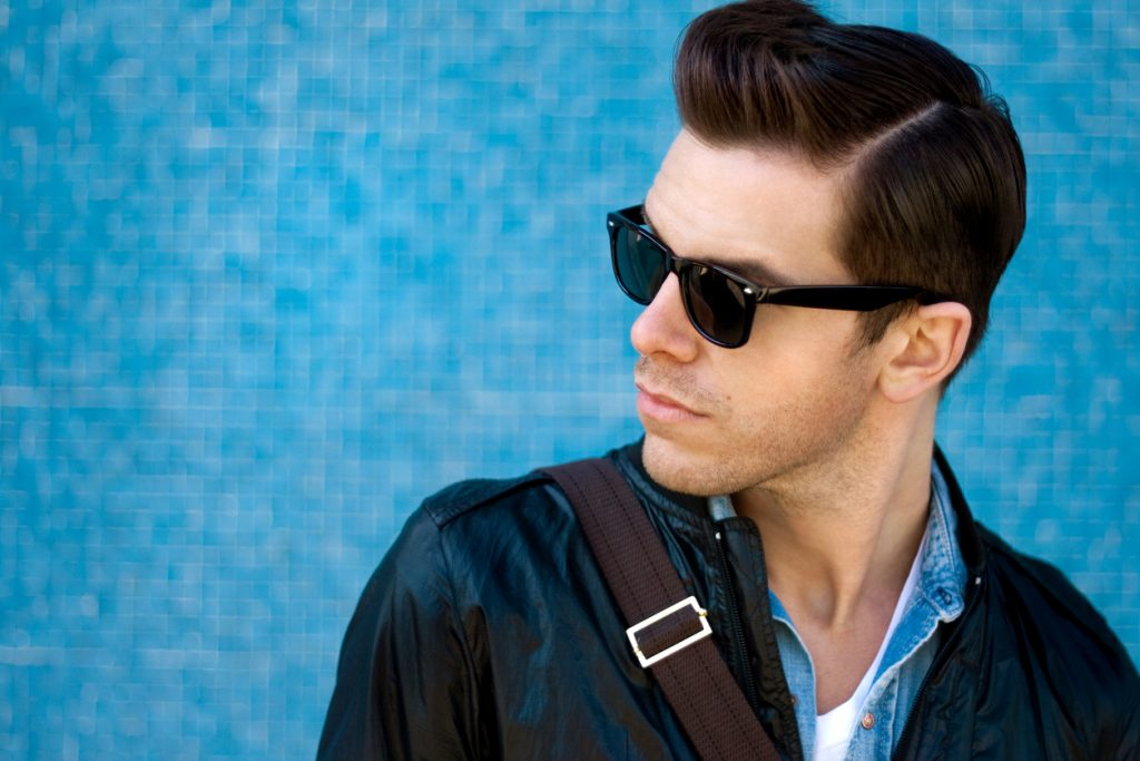 blue background man shades pompadour haircut hairstyle our favorite short haircuts for men toppik hair blog