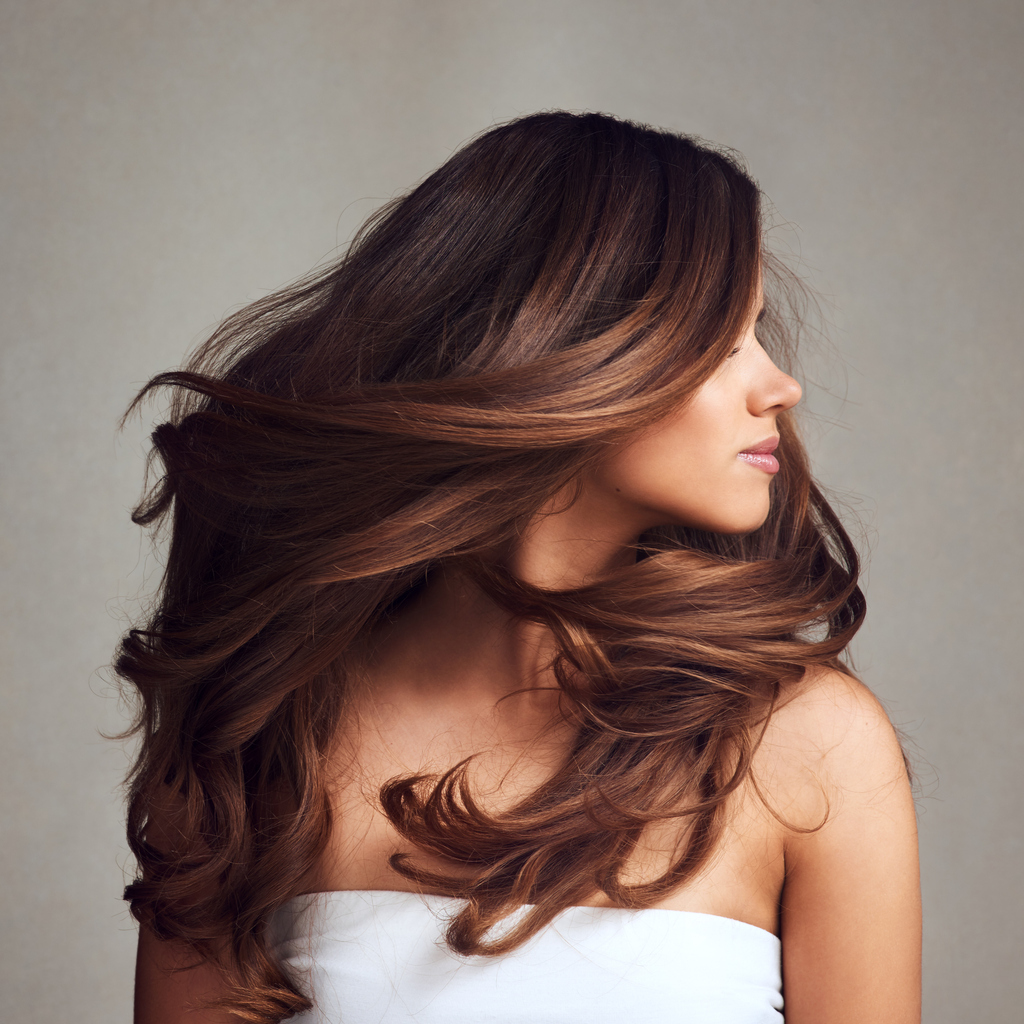 long brown hair woman side turning head fall hair colors trends toppik hair blog