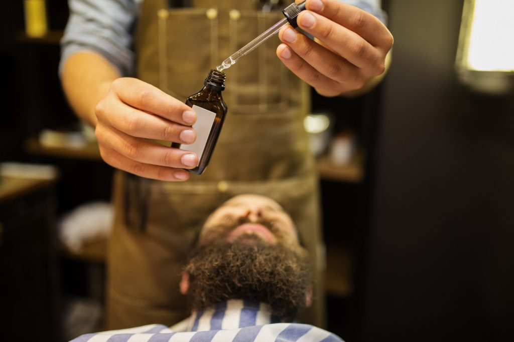 man barber chair grooming beard oil how to get a thicker beard toppik hair blog