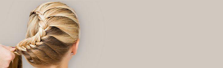 blonde hair woman French braids back light background do braids help Hair Grow toppik hair blog