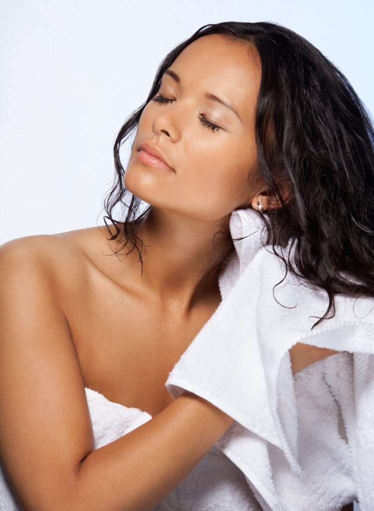 woman drying wet hair towel shampoo wash protect hair while sleeping toppik hair blog
