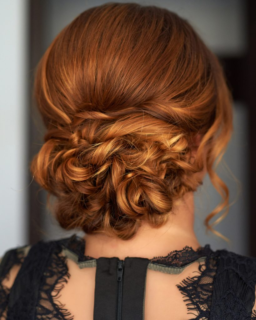 rear view red hair low romantic chignon hairstyle updo shoulder length hair styles for fine hair toppik hair blog