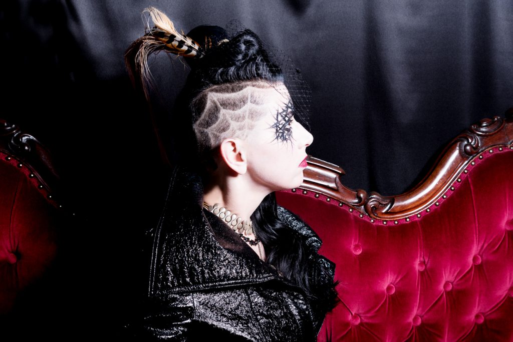 goth woman spiderwebs shaved haircut red velvet sofa halloween shaved hair designs for thin hair toppik hair blog