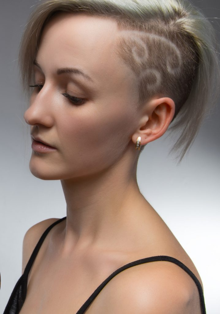 blonde woman shows her Shaved Hair Swirls
