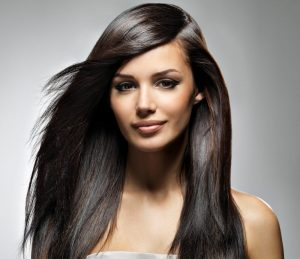 glamorous indian south asian woman long straight shiny hair silk shirt gray background espresso brown hair best hair color for thin hair toppik hair blog