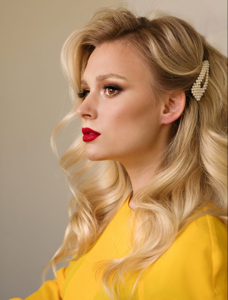 woman wavy blonde hair side view yellow shirt red lipstick pinned loose waves hairstyle hairstyles for valentines day toppik hair blog