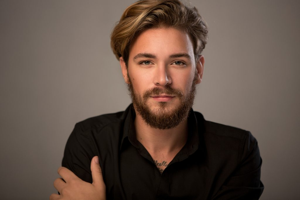closeup handsome man beard blonde voluminous shag haircut shag haircuts for men and women toppik hair blog